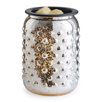 The silver Mercury Glass Illumination, in an all over hobnail pattern, glows when illuminated with golden light. Warm your favorite wax melts for fragrance and ambiance with this new style. Electrical