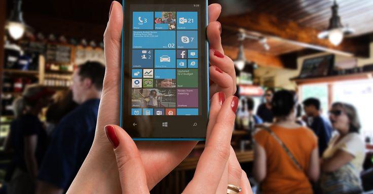 Woman Wearing Gold Ring Holding Blue Nokia Windows Smartphone · Free Stock Photo