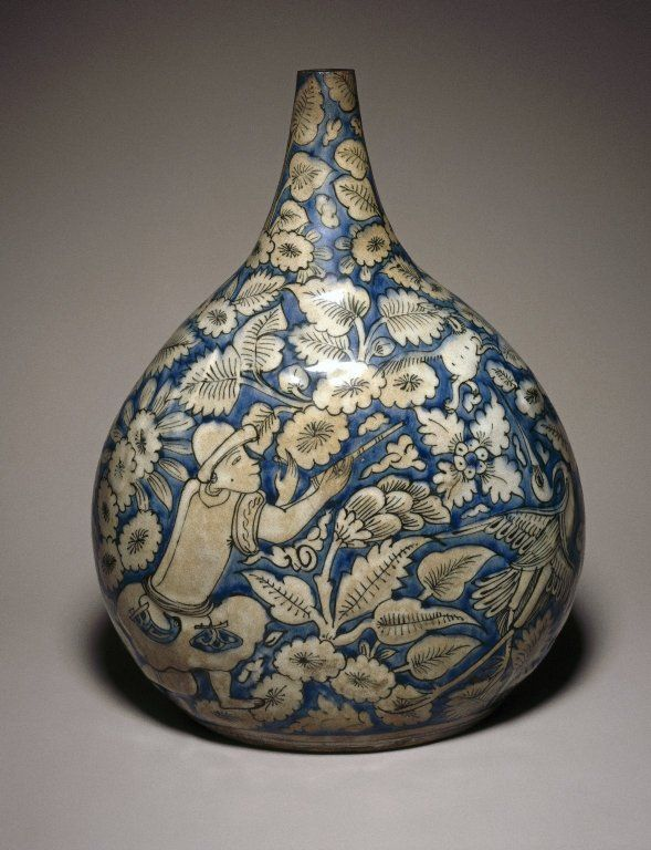 17th C. Safavid ceramic fritware bottle. A hunting scene painted in cobalt blue and black on an opaque white glaze. Probably made in Mashhad Iran. First half 17th C.