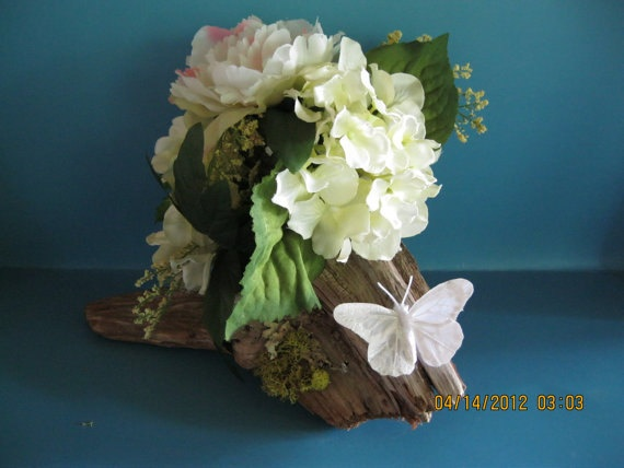 Driftwood wedding centerpiece withgreen and white silkflowers and white butterfly. OOAK. $26.00, via Etsy.