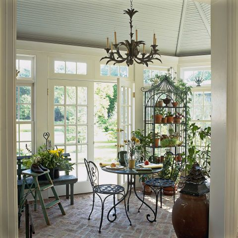Think: Wrought iron accessories, bistro sets, and other garden-inspired decor used indoors. Even if you didn't have a sunroom or conservatory, the creative re-use of these outdoor accents added so much charm.