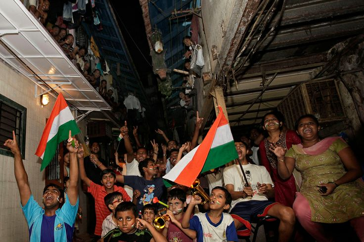 Indian cricket fans watch the ICC Cricket World Cup final match between India and Sri Lanka on a television set in Mumbai, India, Saturday, April 2, 2011. (AP Photo/Rajanish Kakade)