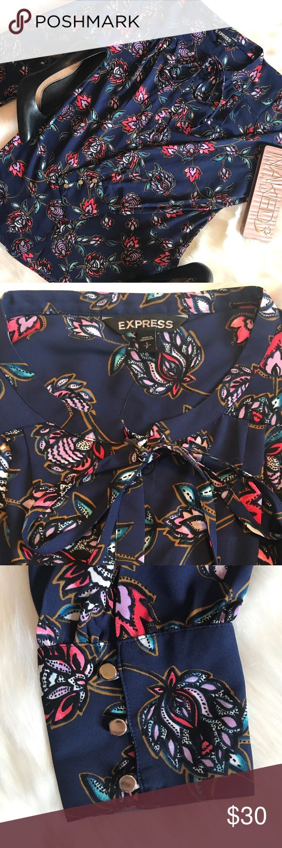 Express Tie Neck Blouse Beautiful floral tie neck blouse that can be worn tied or undone. Pairs nicely with black dress pants and pumps! 100% polyester. NWT Express Tops Blouses