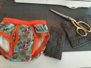 You can make your own DIY toddler training pants by cutting up a cloth diaper insert and putting it in the peepee pocket on toddler underwear. Genius! And so much cheaper than buying trainers.