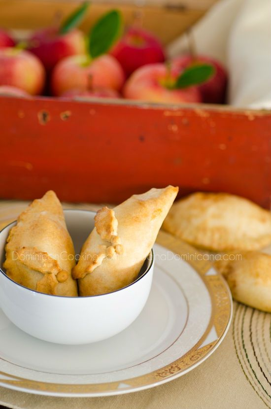 Baked empanadas filled with pork and apples.