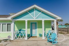 Pastel blue and green cottage in Pensacola Beach, FL.