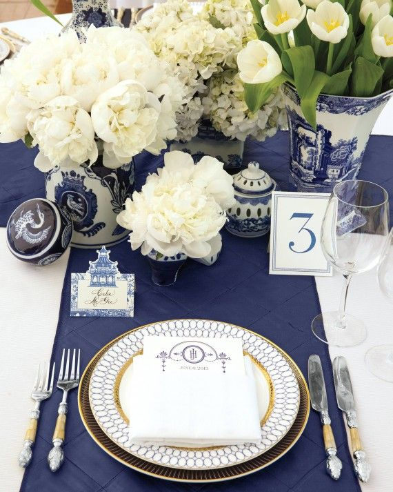 Each place was set with blue somethings, including a midnight-colored runner and chinoiserie vases filled with white buds.