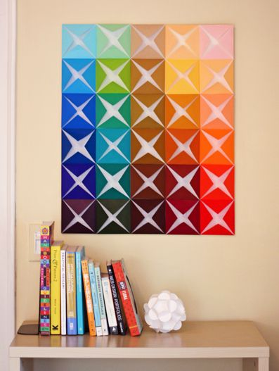 DIY Folded Paper Wall Art (cooler if you added pictures under the folds)