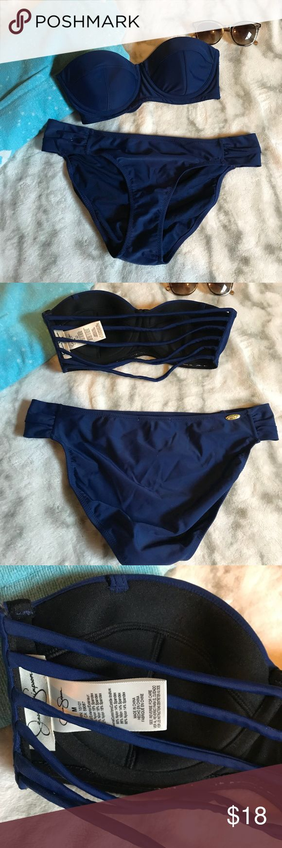 Jessica Simpson sexy navy bikini Adorable strapless suit with strapped back and tons of support. Tried on the suit but never wore it Pet free and smoke free home Jessica Simpson Swim Bikinis