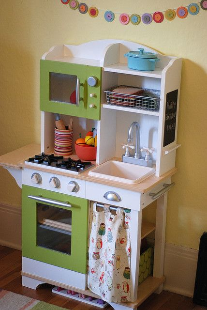 Love this little kitchen for our new playroom, and the fact that she painted it green and added the curtain
