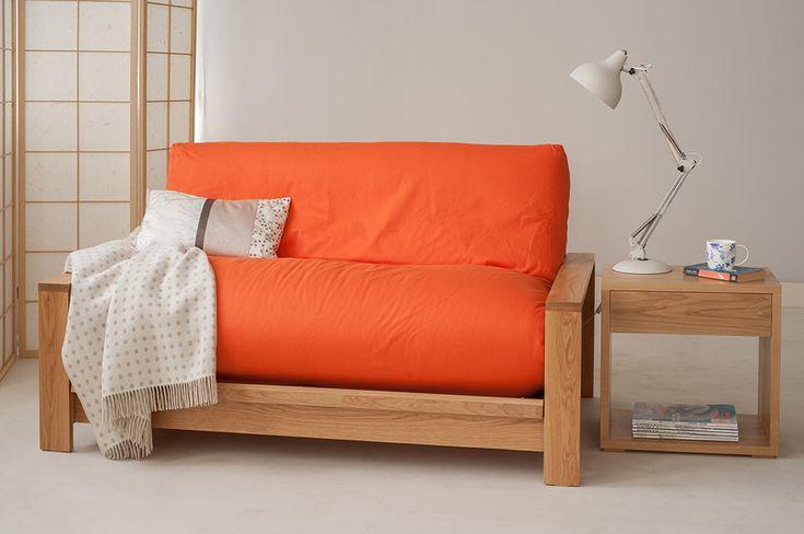 Oak Panama sofa bed with bright orange cover. http://www.naturalbedcompany.co.uk/shop/sofa-beds/panama-futon-sofa-bed/