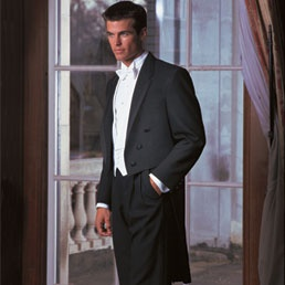 The grooms and groomsmen's tuxedos- black with tails