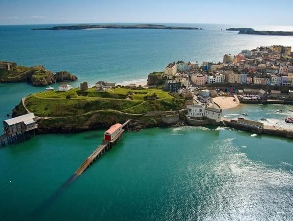 Tenby's Welsh name means 'little fortress of the fishes', a suitably charming name for this walled seaside town. Walk its 13th-century walls, admire its brightly coloured buildings and enjoy a day on its fantastic beaches.