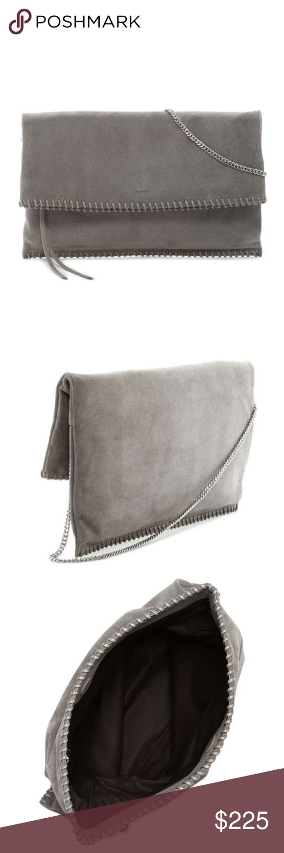 "AllSaints Handbag AllSaints Handbag.  NWT.  Whipstitched leather trim plays up the '70s-inspired vibe of a lush suede fold-over clutch fitted with a polished silvertone shoulder strap that dangles in a gorgeous swoop when not in use. Magnetic closure in fold-over opening. Zip pocket under flap. Interior zip, wall and smartphone pockets. Leather. 14 ¼""W x 9""H x ½""D. 12"" strap drop. 1.5 lbs. All Saints Bags Clutches & Wristlets"