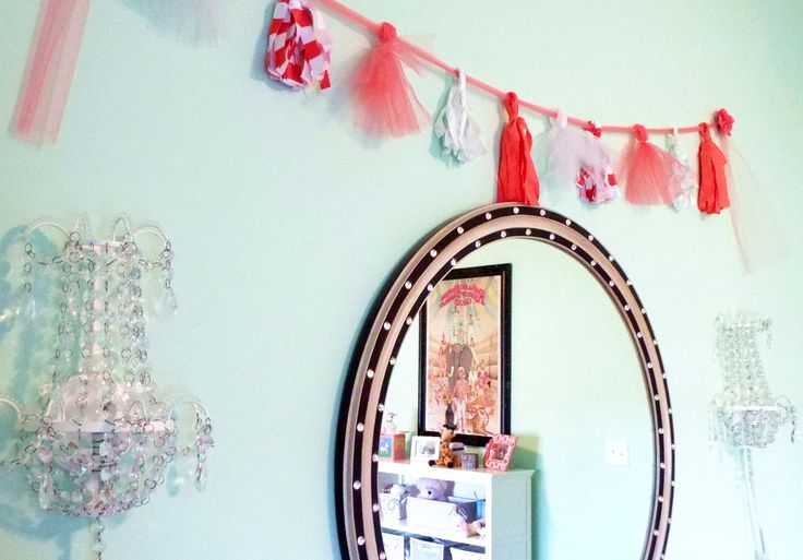 Coral, tulle, mint, tassel banner, crystal sconces, black and gold mirror, vintage circus poster, pink toddler room by Ellebright Designs