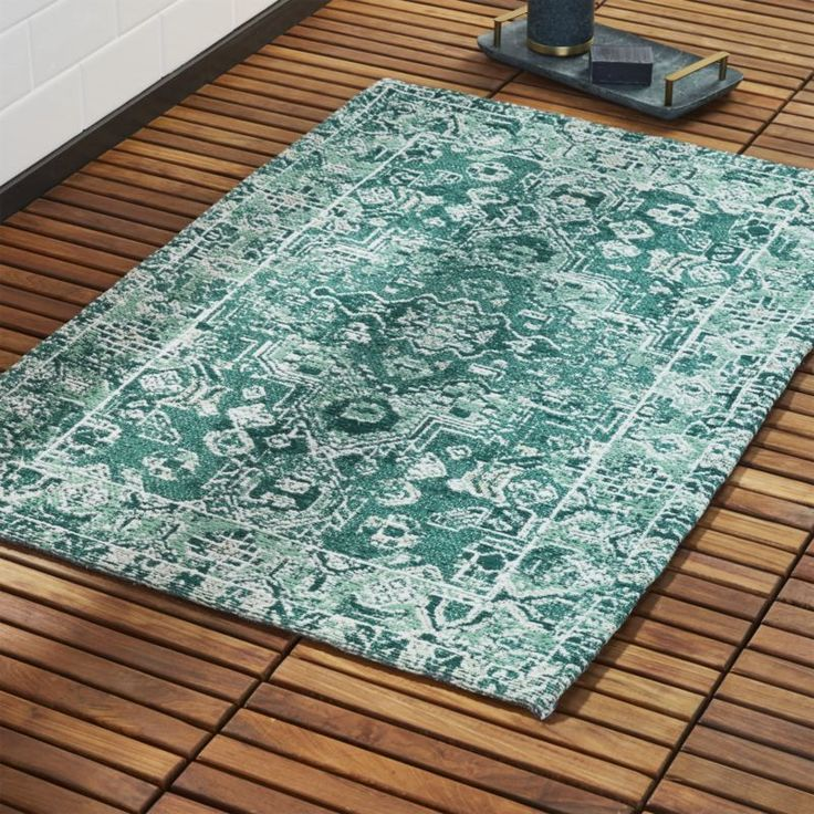 Shop Sadie Teal Bath Mat.   Beautiful Moroccan-inspired teal pattern makes its way to the bathroom.  Slow-fade look and soft-hand feel mimics that of a pricey vintage piece.  Not meant for bathtub/shower use.  CB2 exclusive.