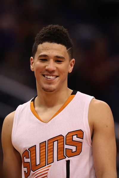 Devin Booker Photos Photos - Devin Booker #1 of the Phoenix Suns reacts on the court during the second half of the NBA game against the Oklahoma City Thunder at Talking Stick Resort Arena on March 3, 2017 in Phoenix, Arizona. The Suns defeated the Thunder 118-111. NOTE TO USER: User expressly acknowledges and agrees that, by downloading and or using this photograph, User is consenting to the terms and conditions of the Getty Images License AgreemenOklahoma City Thunder t. - Oklahoma City…
