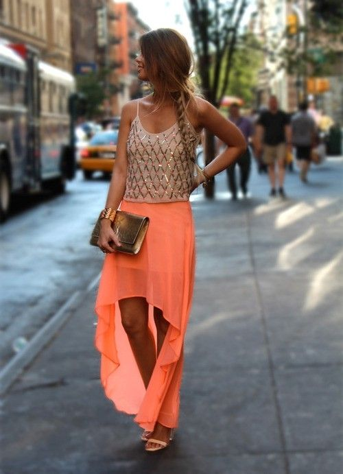 Bright orange high low maxi skirt with embellished tank top and gold clutch. Nice for an evening out.