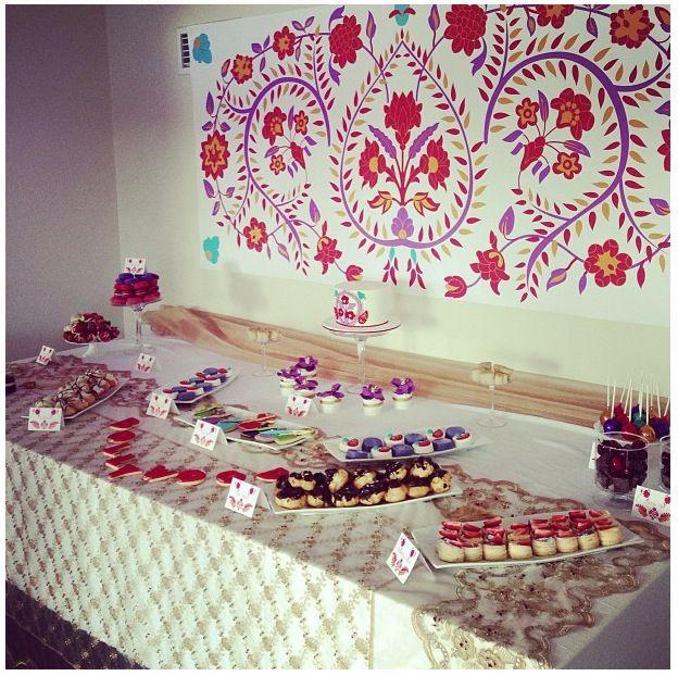 Bollywood themed dessert table - colour scheme purple, red and gold