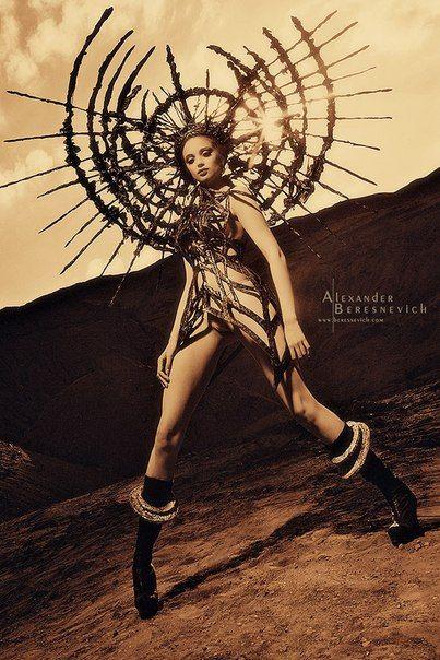 Huge dramatic sunburst headpiece futuristic burner warrior goddess queen fashion editorial photography