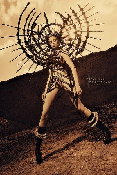Huge dramatic sunburst headpiece futuristic burner warrior goddess queen fashion editorial photography