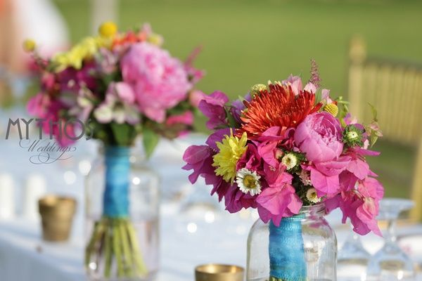 Boho style Table decoration - small vases with wild colorful flowers and gold votives #weddingdecoration #tabledecoration #weddingflowers