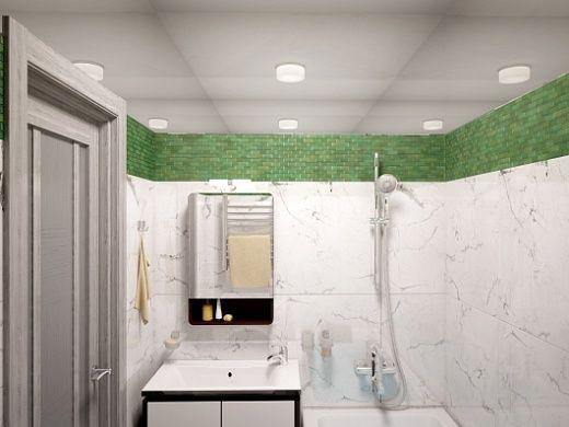 Для облицовки ванной комнаты была выбрана белая плитка, имитирующая по цвету и фактуре полированный мрамор, а также стеклянная зеленая мозаика, размеры сегментов которой – 20х42х8. Зеленая мозаика идет под потолком, что придает свежести в целом белому помещению. Половина стенки за унитазом тоже сделана из зеленой мозаики. Площадь ванной комнаты позволила установить напольную ванну (1700х750ъ580), а не душевую кабинку. Также нашлось место для важной бытовой техники – стиральной машины.