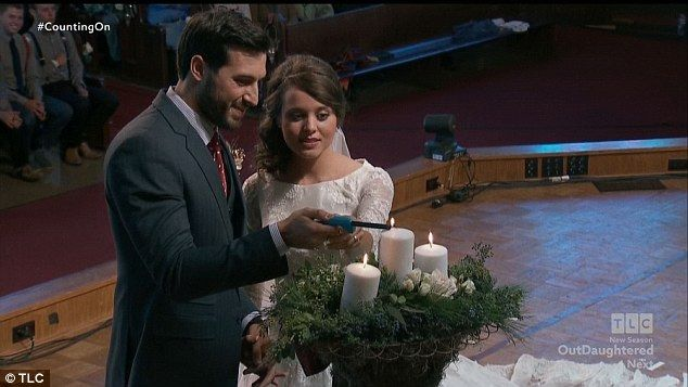 Symbolic meaning: Jeremy and Jinger struggled with the candle ceremony but figured it out...