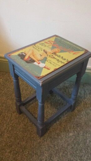 Coffee table with vintage repro garage metal sign from www.facebook.com/beetreecrafts