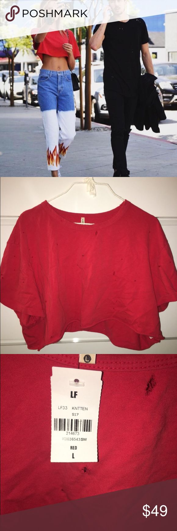LF red distressed crop top brand new (Worn by Romee in the picture) this top is sold by LF but cannot be purchased online. It is brand new with tags still attached. Says size large on the tag but can be worn as oversized for anyone size S-M. LF Tops Tees - Short Sleeve