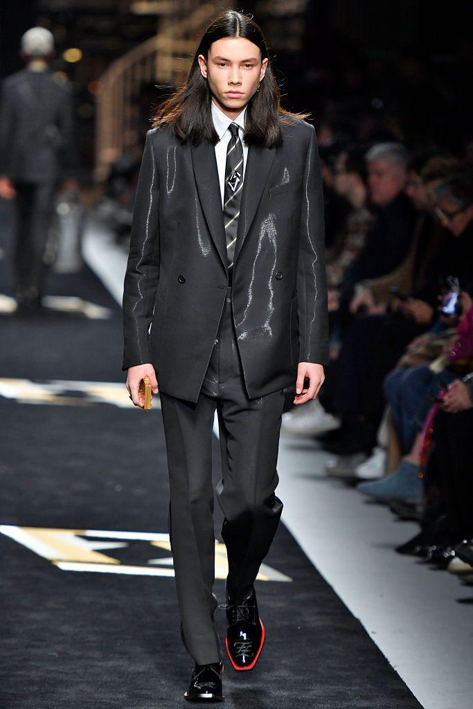 fe6658d66e5 A model walks the runway at the Fendi show during Milan Menswear...