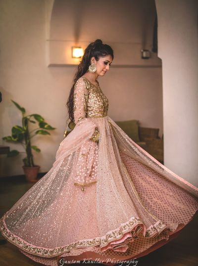 Twirling Bride - Bride in a Peach and Gold Lehenga with Sequinned Work | WedMeGood #wedmegood #indianbride #twirling #indianwedding #pink #gold #sequinned #bridal #lehenga