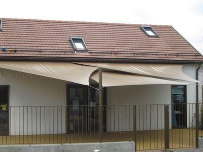 Voiles d'ombrage STOLL Stores & Bâches SA - Vos rêves... nos solutions ! Bâches - Abris-tentes - Camping - Stores - Pergolas - Architecture textile - Piscine - Publicité - Nautisme - Voile solaire