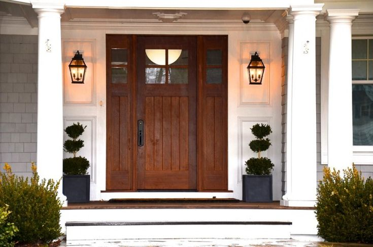 craftsman style front door pillars window lamps decorative plants beach style entry of Elegantly Beautiful Craftsman Style Front Doors to be Amazed By
