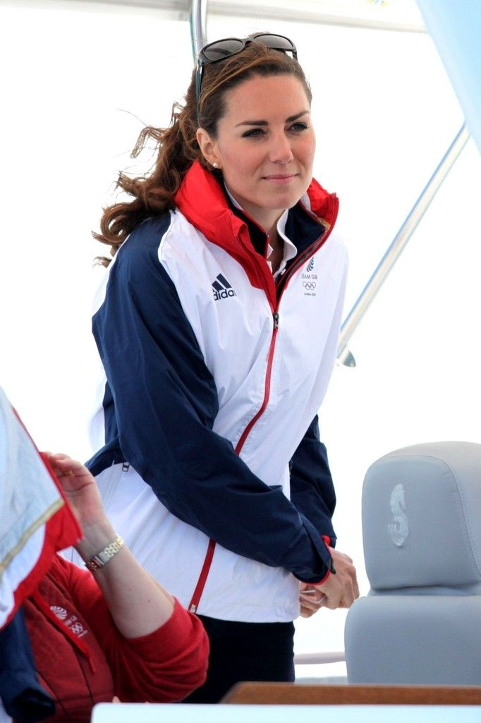 ate Middleton Photos Photos - Catherine, Duchess of Cambridge, enjoys going sailing and meeting Ben Ainslie and the rest of Team Great Britain in Weymouth, England during the 2012 London Olympics. The Duchess wears Olympic gear including a red, white and blue windbreaker and red sneakers. - Kate Middleton at the Olympics