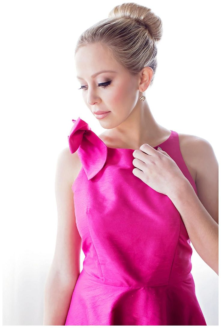 Bright pink bridesmaid dress with a bow at the shoulder from Southern Bridesmaids, image by Magen Davis Photography.