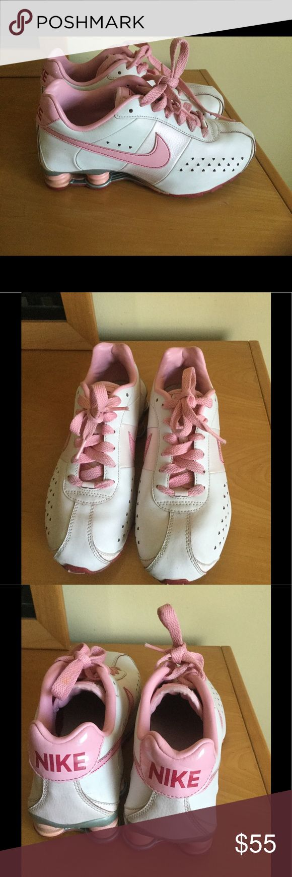 Nike Shock pink leather running shoes In very good condition , no major problems , no rips or spots 90% life left on them . It's a Sz 6 Y , but I worn them Sz 7 women's . ❌Price firm Nike Shoes Athletic Shoes
