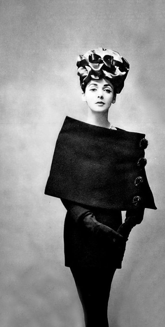 "Model in Balenciaga Haute Couture sheath, tunic & cape by photographer Georges Saad for ""L'art et La Mode (Oct/Nov 1956)"