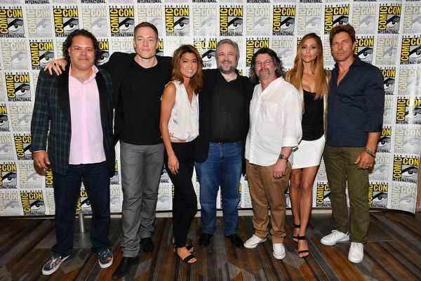 """(L-R) Actor Aaron Douglas, actor Tahmoh Penikett, actor Grace Park, writer David Eick, producer Ronald D. Moore, actor Tricia Helfer and actor Michael Trucco at the """"Battlestar Galactica"""" Reunion press line during Comic-Con International 2017 at Hilton Bayfront on July 20, 2017 in San Diego, California."""