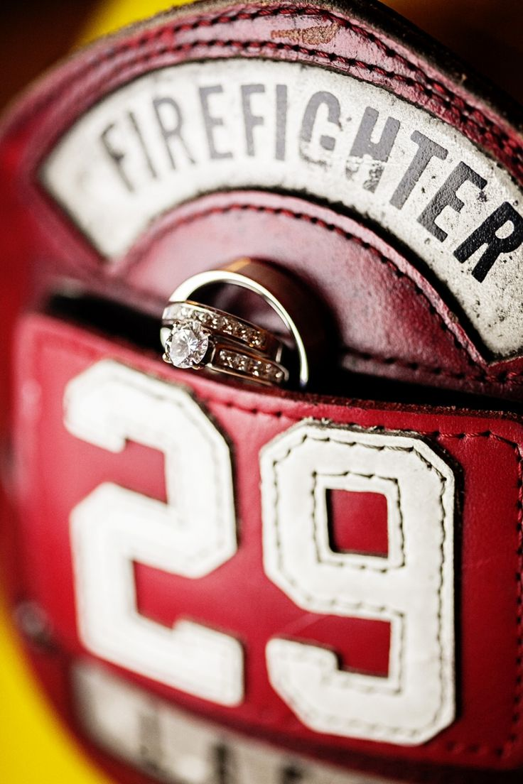 Wedding ring shot on his helmet.. Instead of ring pillow, have fire helmet with leather patch pouch holding rings, with wedding date stitched in .. On back have Mr. And Mrs. Baker ..