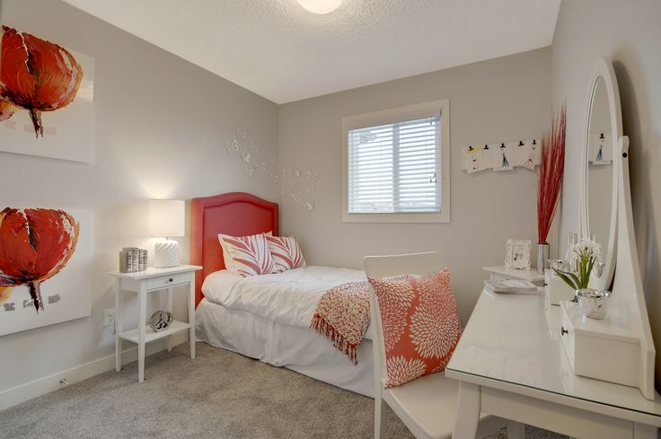 This bright white and peach accented kids room is fun and inviting. It could also be used as a guest room.