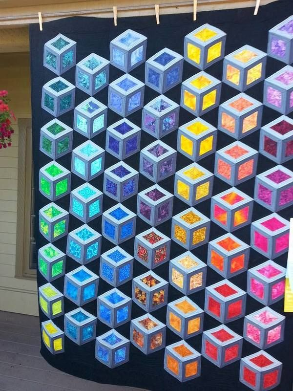 I love this tumbling block Quilt.  The whole thing just pops !!!--TD.