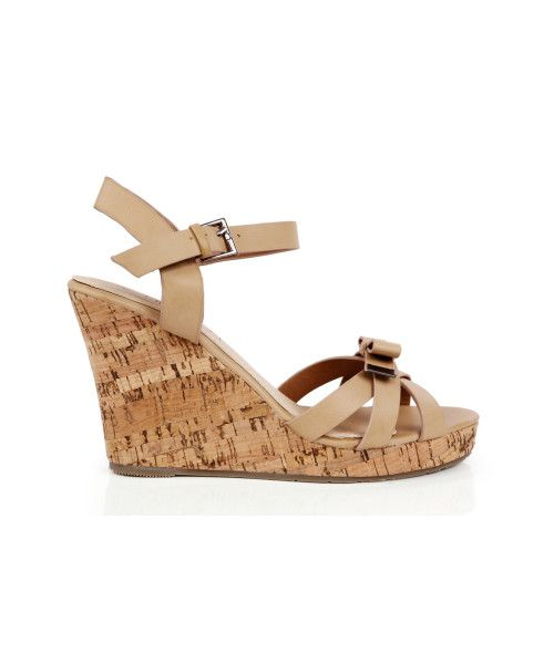 Pump up some fun with #SmittenKitten at #INTOTO #wedges #beige #beigewedges #heels #INmyshoes