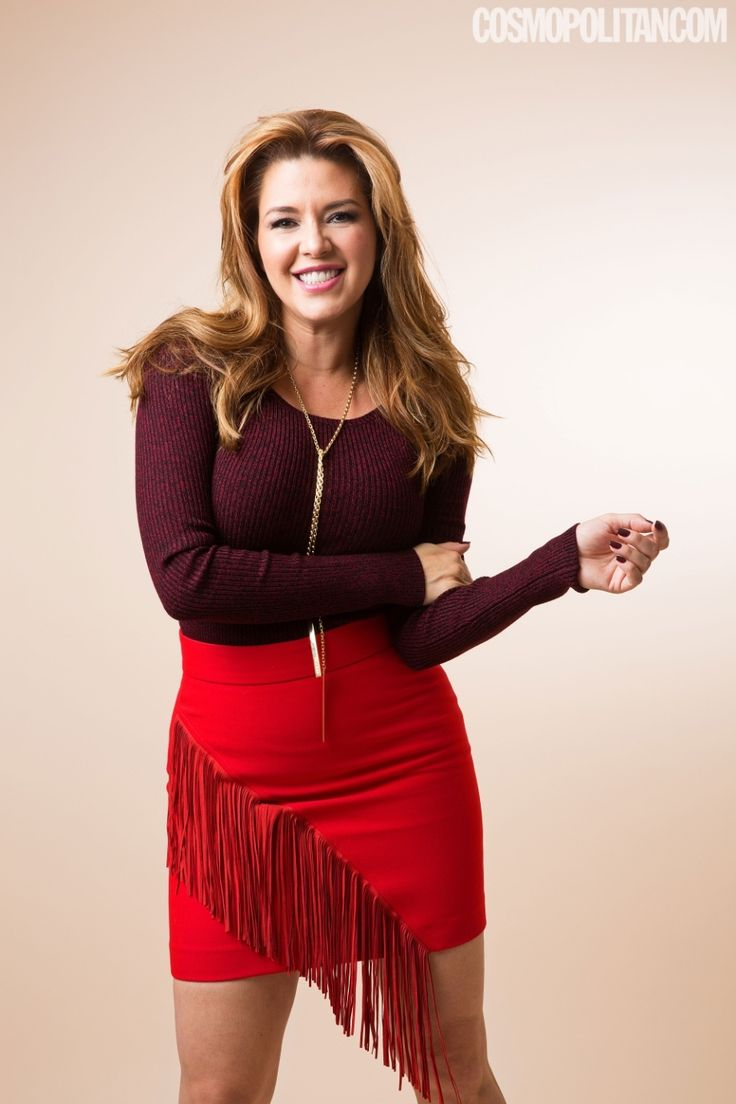 Miss Universe Alicia Machado Responds to Donald Trump by        looking fabulous   Burgundy Sweater, MAJE, $240; Gold Necklace, SARAH MAGID, $248; Red Fringed Skirt, MAJE L, $250 (all available at Bloomingdale's)