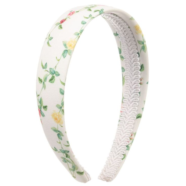 This pretty hairband by Love Made Love has a delicate floral print on a satin covered band. A lovely accessory to complete a special occasion outfit.