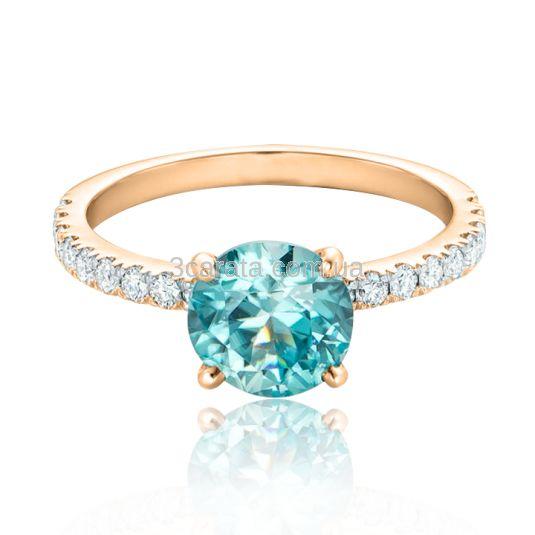 Золотое нежное кольцо с топазом и цирконием будет радовать своим блеском! Золото 585 пробы. Вес изделия - 2,5 грамма. Характеристики вставок: топаз - 1,5 Ct., куб.цирконий.