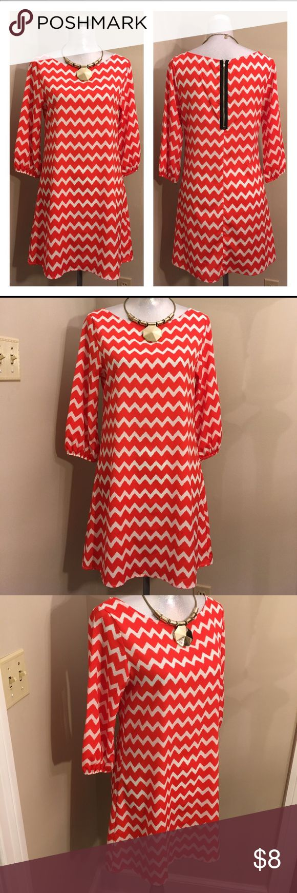 """Auditions Fashion Orange Chevron Dress Size 6 Worn once. No condition issues. 100% Polyester. Marked size small. Shown on my size 6 mannequin. Please compare measurements with something in your closet. You might need to wear something under this. It's a thin dress. Sleeve length 17.5"""" 3/4 length sleeves. From back of neck to hem 31"""" inches. Underarm to underarm 19"""" inches. Waist 36"""" inches. This is a very dark orange. Almost red. Necklace sold separately. Auditions Dresses Mini"""