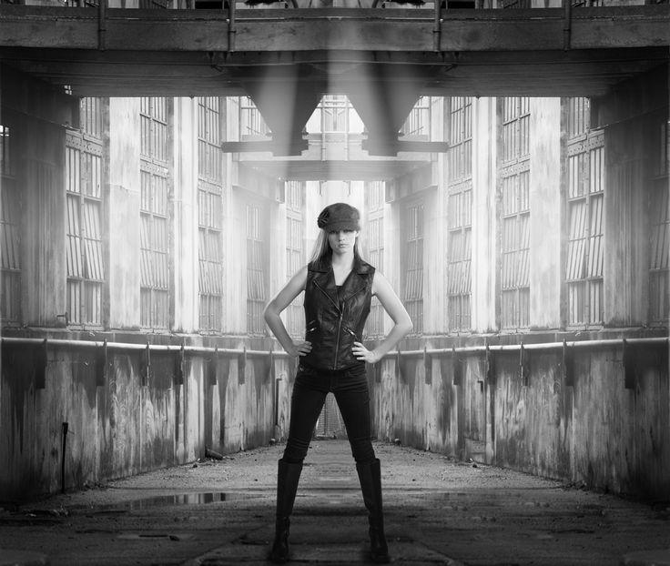 Model's portrait I took in studio using edge lighting techniques.  Composited in photoshop using b
