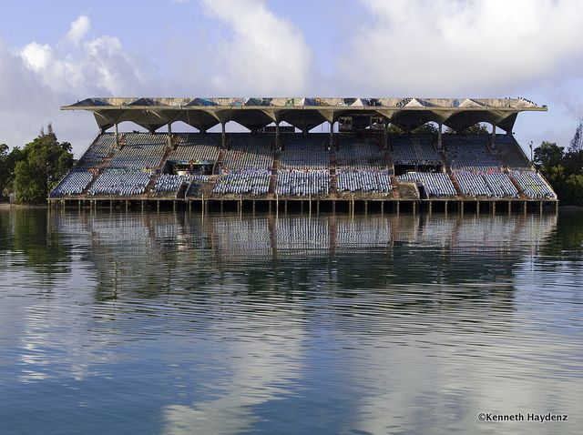 For over two decades, local artists have been fervently and fantastically vandalizing a massive abandoned waterfront structure that lies on a small piece of land, carved in between Miami's urban north and natural south bays.This partially-floating concrete giant—the Miami Marine Stadium—has been technically off-limits to the public since Hurricane Andrew slammed southern Florida in 1992, but the place has been all but vacant since then.