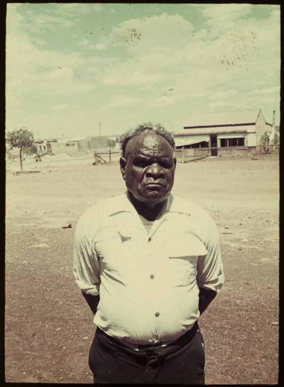 139284PD: Older Aboriginal man on the dirt road with a house in the background, exact location unknown, Western Australia, ca. 1965. http://encore.slwa.wa.gov.au/iii/encore/record/C__Rb5529245